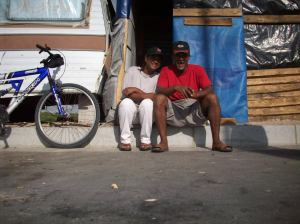 Ridwaan Isaacs with his wife outside their home
