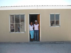 Ethel Abels and her daugther in front of their new home