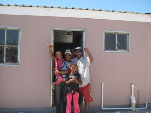Jolene Arendse and her family in front of their new house